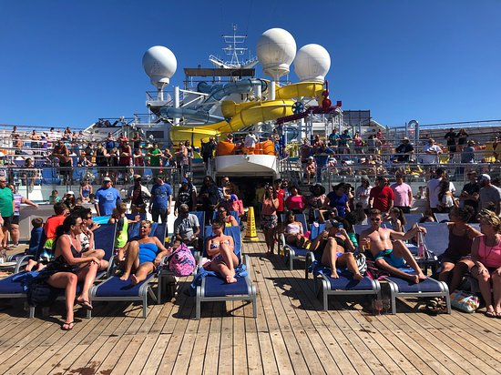 View of the Carnival Glory - looking toward the water slides. This was a sea day so very crowded.