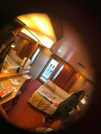 Carnival Triumph: Outdated room. Smelled sewage most of the trip. First cruise. Director was great as were shows. Food was gross 1/2 time. Staff a++++
