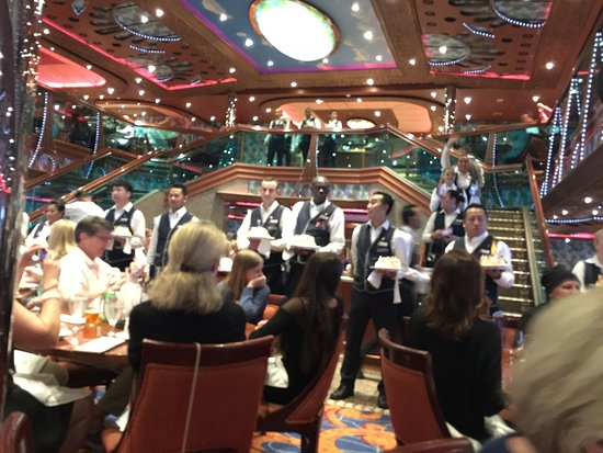 Carnival Conquest: Dining room staff entertainment