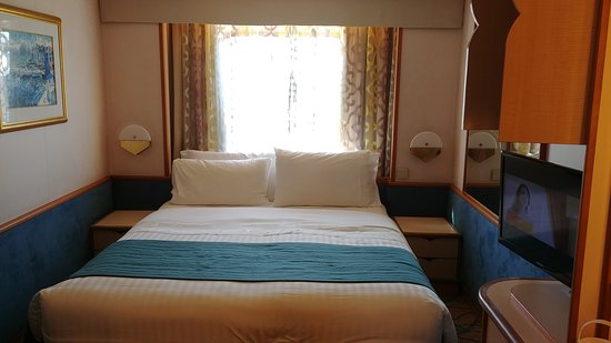 Rhapsody of the Seas: This is our ocean view cabin....loved the fact I could check the weather, w