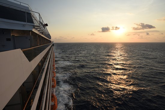 Carnival Victory: View off the side looking back at the sunset.
