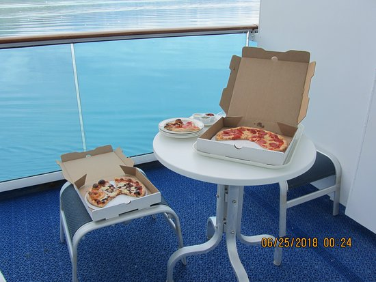 Coral Princess: Room service pizza on the balcony during viewing of Glacier Bay.