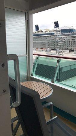"Explorer of the Seas: ""Spacious Ocean View Balcony"" stateroom. Balcony had a small table"