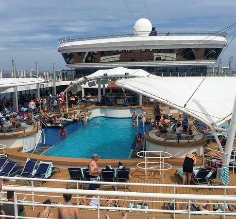 Norwegian Dawn: Smallest pool ever on a cruise ship. Don't think it can even hold 50 people. Very