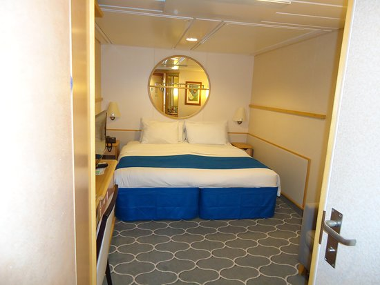 Adventure of the Seas: View into cabin bedroom from door entry