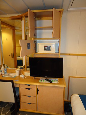 Adventure of the Seas: Cabin has a safe, TV, drawers available. Storage behind glass/mirrors for m