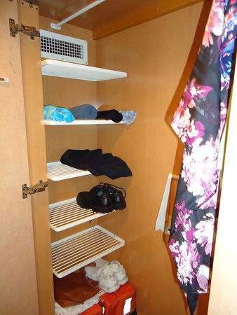 Adventure of the Seas: Closet provides shelves, requested more hangers to use for our clothes.
