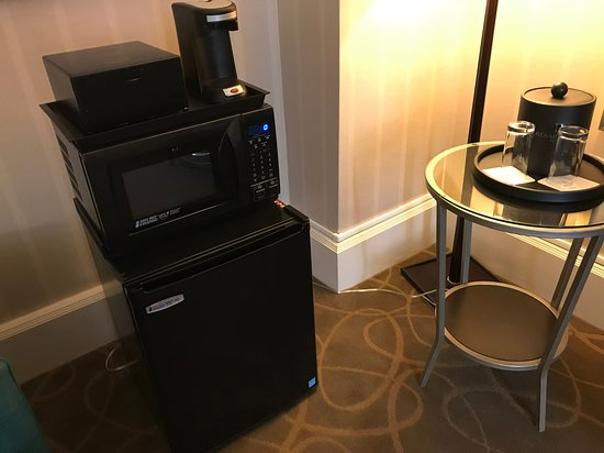 Microwave, fridge, and coffee maker,sitting on the floor and not plugged in