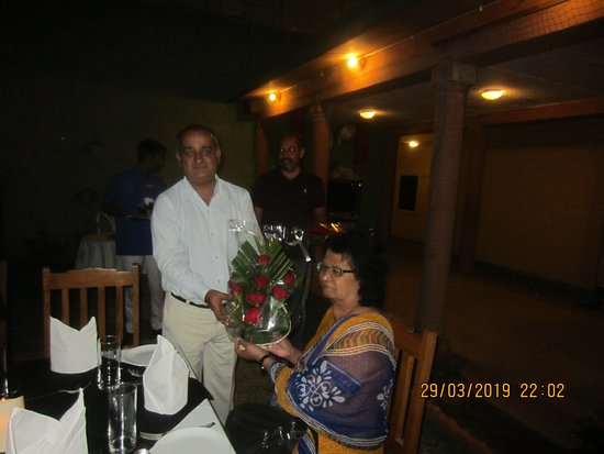 GM presenting a bouquet for Ruth