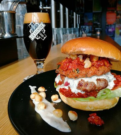 De Gist: MAROCCAN Burger of the Week 😋 a 200gr beef patty topped with falafel, herb yoghurt, harissa and toasted hazelnuts 🌰 order it after 12PM, every day!
