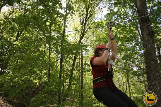 Mammoth Cave's Canopy Zipline Tour: Maria zipping across one line