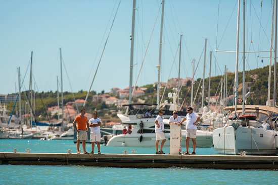 Navigare Yachting crew on the dock