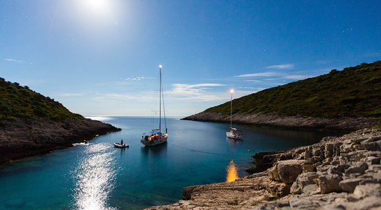 Navigare yachting yachts in a cove in Adriatic sea