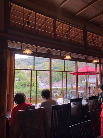The restaurant has a view out to the terrace and gardens and the hills of Kyoto.