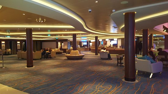 Norwegian Escape: Atrium when in port. It was easy to find seats then. At night...not so easy