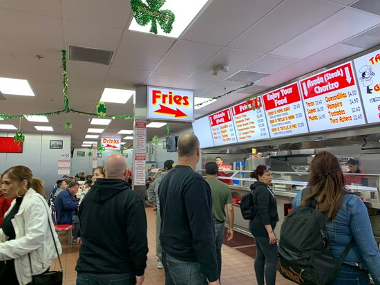 Tacos el Gordo: The sign says it all! Fries are this way! Carne Asada fries are the best!