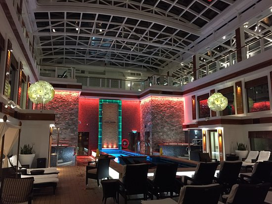 Norwegian Escape: The Haven courtyard at night. When the canopy is closed, the courtyard is a