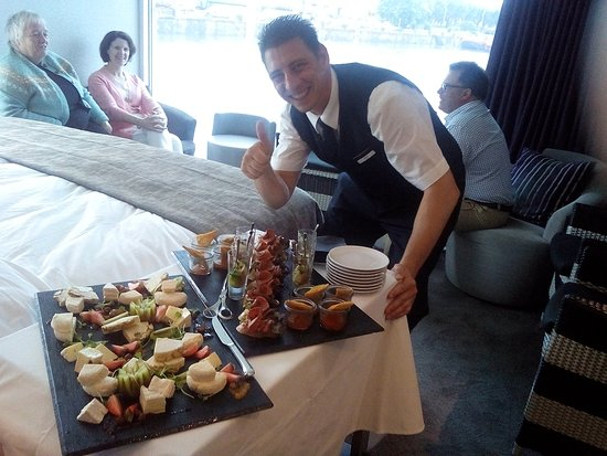 Scenic Diamond: Butler serving food and wine in our cabin
