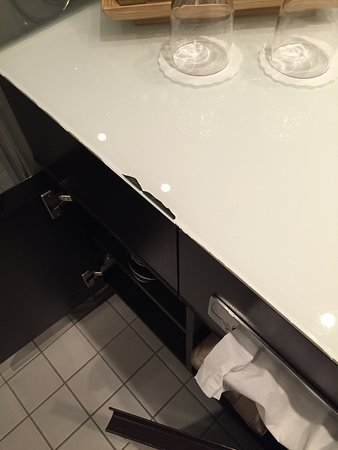 Scenic Ruby: Chip off countertop in bath