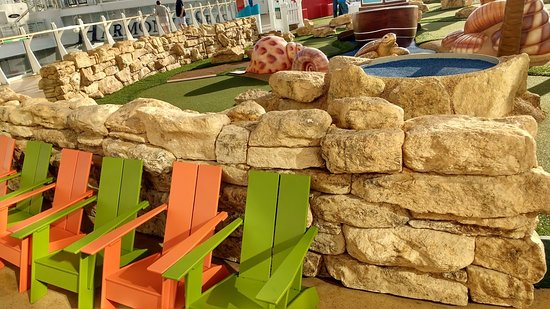 Harmony of the Seas: Children's seating outside minigolf.  An extra touch :)