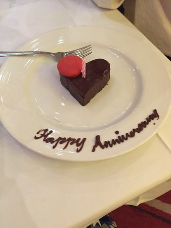 Carnival Sunshine: We celebrated our anniversary on the ship and our waiter brought us a cake!