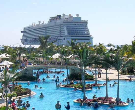 Norwegian Getaway: A better view of the cruise ship and pool, from the second floor of Land Sharks Grill, it seems like its flying over the pool!  At Harvest Caye Belize