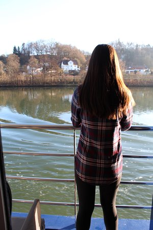 AmaStella: My daughter on the balcony while sailing on the Danube.