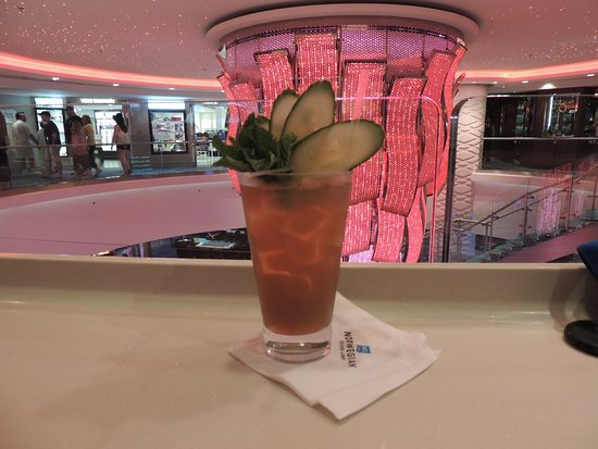Norwegian Escape: Sipping a mojito in one of the atriums waiting for dinner at Bayamo(a la ca