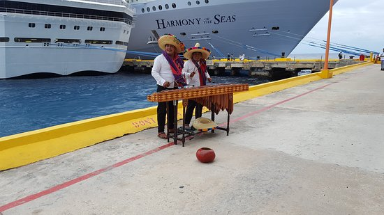 Harmony of the Seas: Leaving Costa Maya,  Mexico to geniuses the Harmony.  Locals dressed up playing the xylophone.