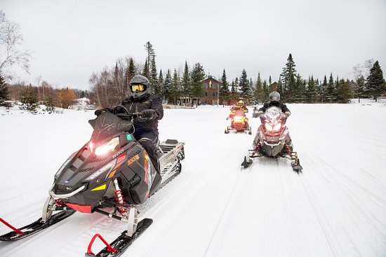 Snowmobilers leaving Skyport Lodge