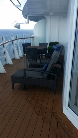 Harmony of the Seas: Sitting area of the balcony.  There are two sliding doors, one from the liv