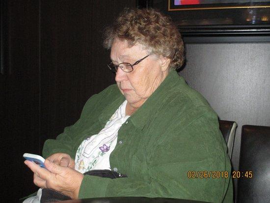 Norwegian Breakaway: My friend Sharon using her cell phone to keep track of her memories.