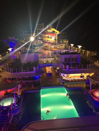 Norwegian Breakaway: From the sun deck at night - only a few braved the wind to enjoy the pool.