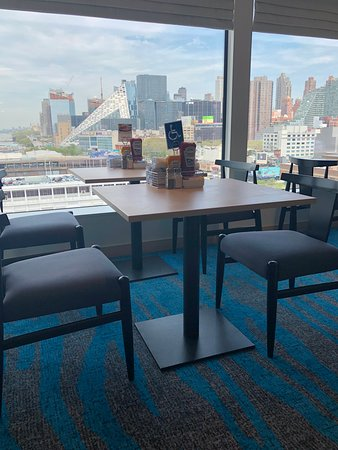 Norwegian Bliss: Seating in cafeteria allows for individuals in wheel chairs and are designa