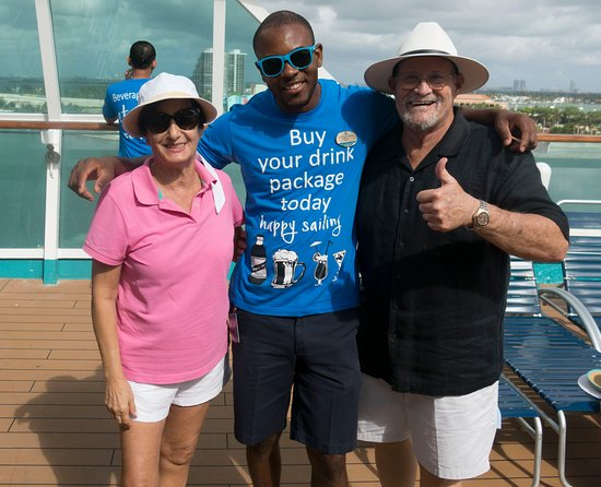 Empress of the Seas: Meryle and I with our Bar Man Anthony whom we befriended on our first Empre