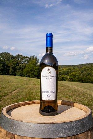 Blueberry Mead on an oak barrel in the field.