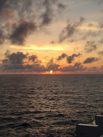 Norwegian Escape: One of the beautiful sunsets from our balcony
