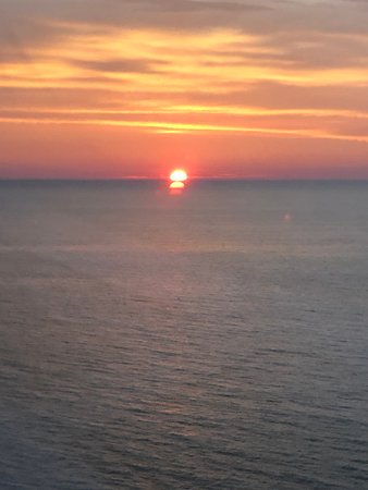 Viking Sea: Our cruise was Into the Midnight Sun this is a photo of the sun setting at