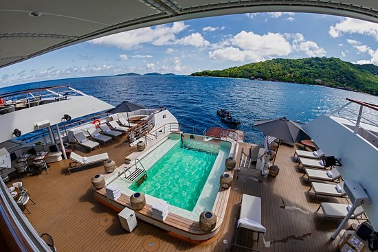 The pool deck of Le Laperouse anchored off La Digue island in the Seychelle