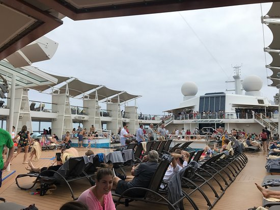 Celebrity Reflection: Guests having fun at one of the pools!