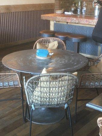 Jalisco Cantina: Steel table tops near the bar