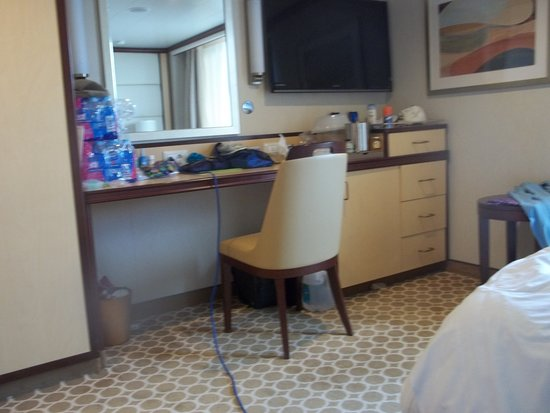 Royal Princess: Looking across cabin from beds. Large desk, Fridge, storage & TV.