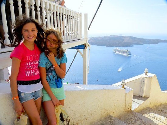 Celebrity Equinox: Girls in Santorini with ship in background