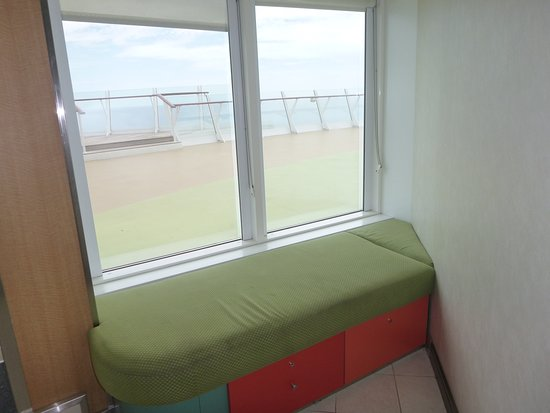 Oasis of the Seas: Here's a funny little spot we found, just inside of the sundeck. My husband sat down while I went outside to check it out, and fell asleep!