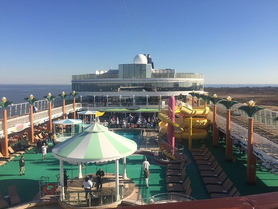 Norwegian Jade: What looks like a glass box by itself on the top deck is our stateroom