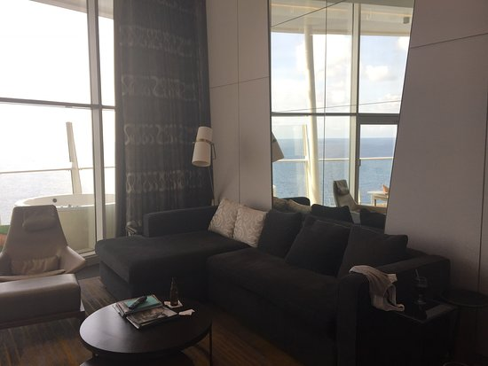 Oasis of the Seas: Living room area with couch and chairs.