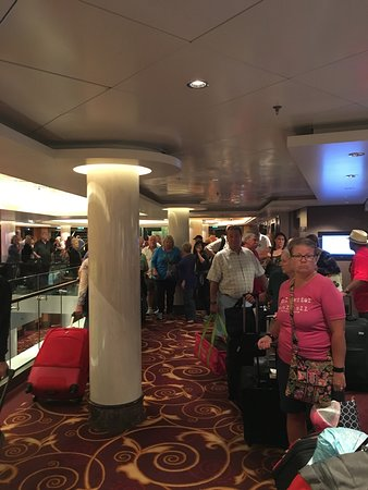 """Norwegian Epic: part of the line of over 2000 people attempting """"easy"""" debarkation"""