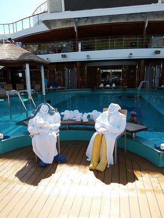 Carnival Magic: Towel people at the pool