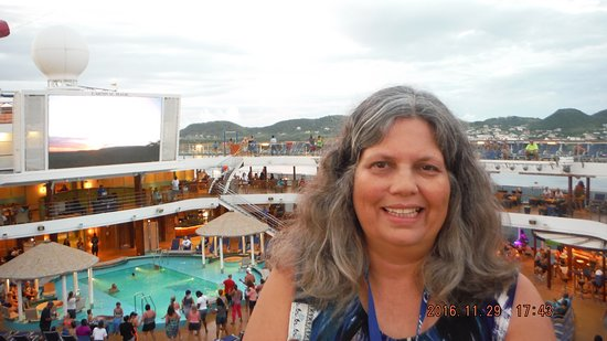 Carnival Magic: A hot sexy mama selfie of me with the Lido Deck Pit in the background.