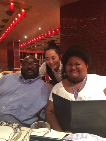 Carnival Dream: My husband and daughter in the main dining room with one of our servers. S